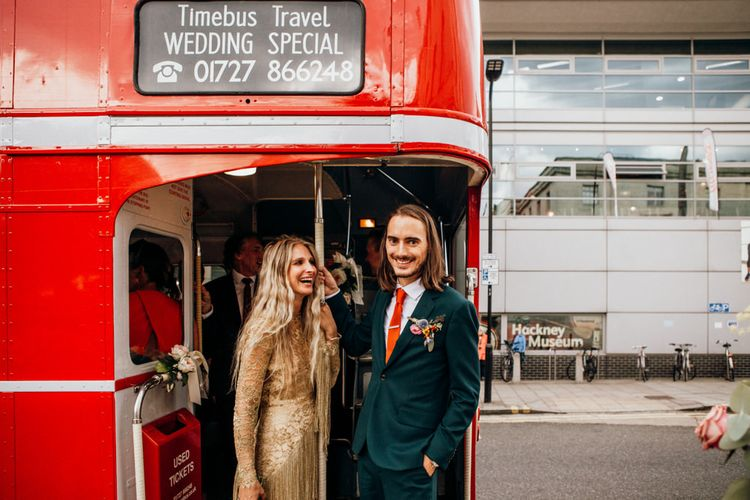 Bride and Groom on Red London Bus for Wedding Transport