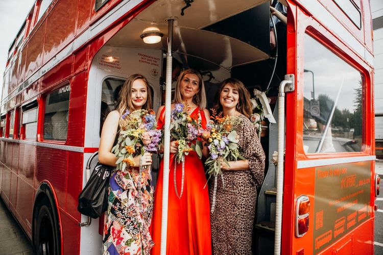 Mismatched Bridesmaid Dresses with Bridal Party on Wedding Transport Bus