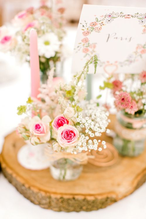 Pink and White Flower Stems in Vases as Centrepieces