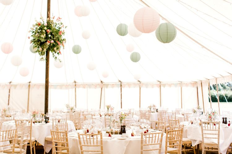 Marquee Wedding Reception Decorations Including Hanging Paper Lanterns and Floral Arrangements