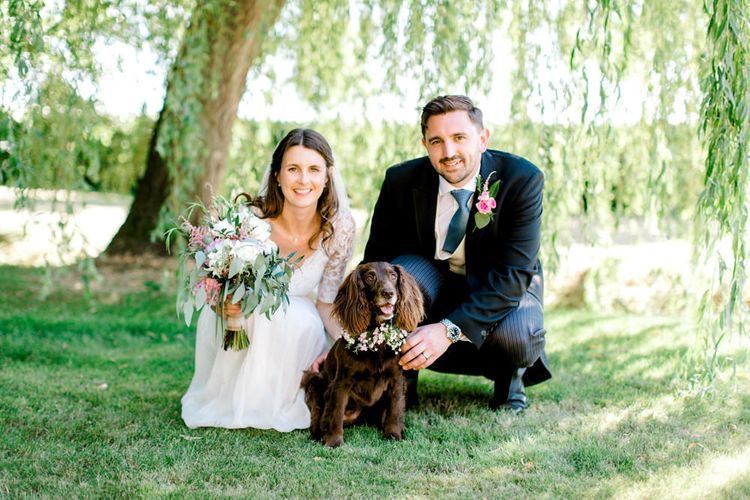 Bride in Dana Bolton Wedding Dress and Groom in Morning Suit with Pet Spaniel Dog