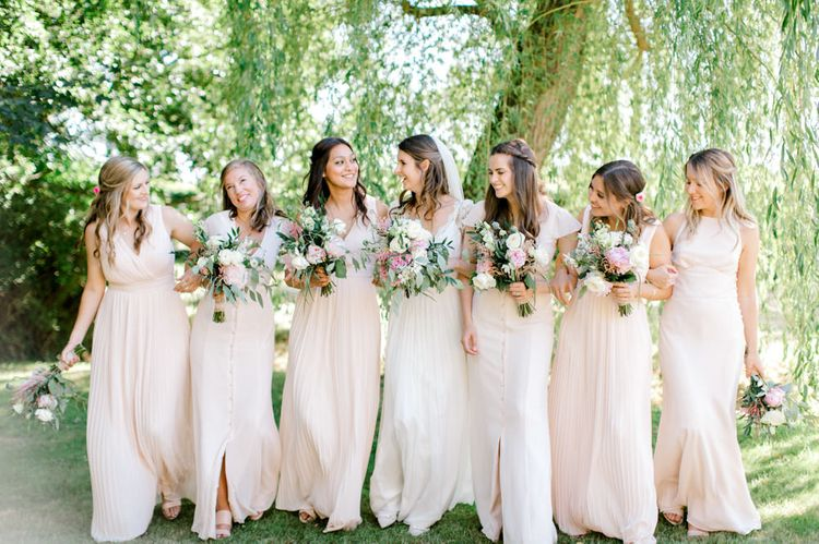 Bridal Party Portrait with Bridesmaids in Pastel Pink TFNC and Maids to Measure Dresses and Bride in Dana Bolton Wedding Dress