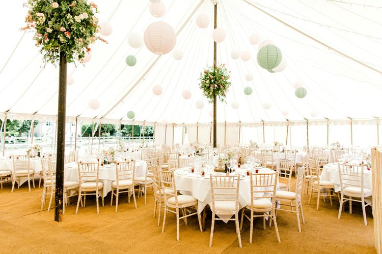 Marquee Reception with Hanging Paper Lanterns and Floral Arrangements