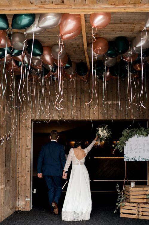 Peach, Silver and Green Balloon Ceiling Wedding Decor