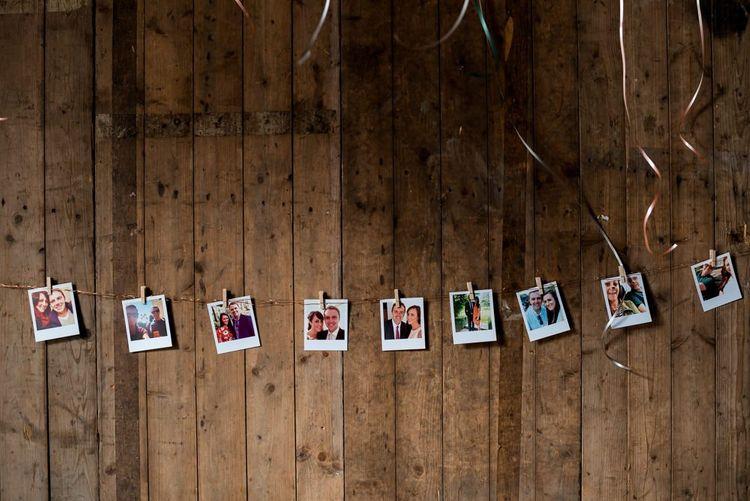 Strung Up Polaroid Picture Wedding Decor