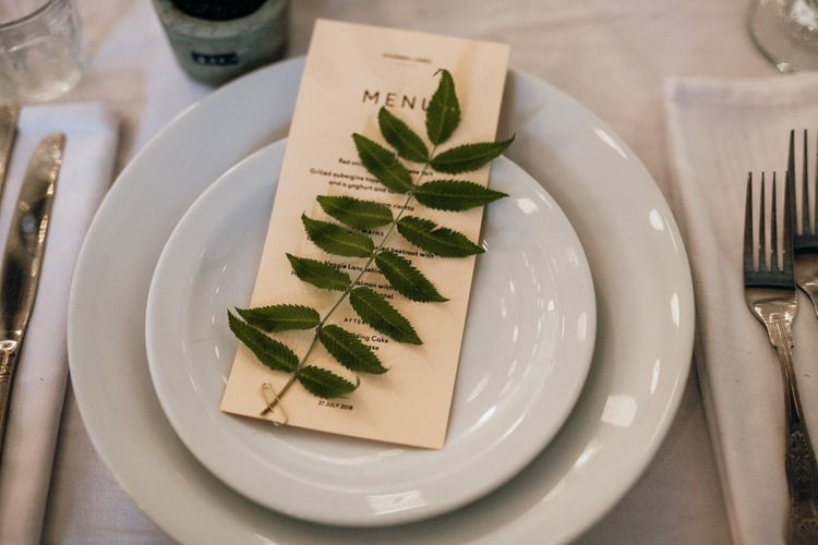 Table Place Setting at Wedding With Foliage