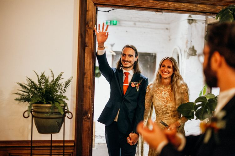 Bride and Groom Entering Ceremony Room