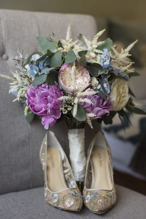 Summer Bridal Bouquet with Purple and Blue Flowers and Eucalyptus | Floral Embroidered Chloe Shoes by Bella Belle | Morris Minor Wedding Car, Hanging Flowers in Bottles and Town Crier for Village Hall Wedding in Rye | Eleanor Jane Photography