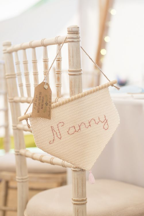 Personalised Flag Wedding Favours | Tipi Wedding Reception at Udimore Village Hall, East Sussex | Morris Minor Wedding Car, Hanging Flowers in Bottles and Town Crier for Village Hall Wedding in Rye | Eleanor Jane Photography