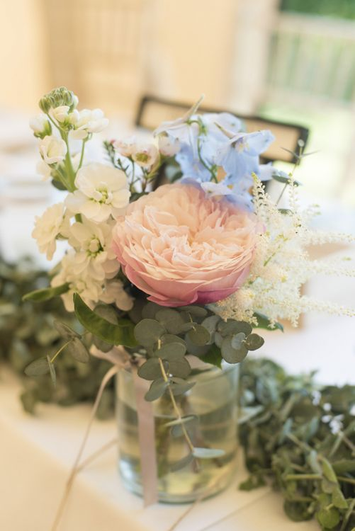 Pink, Blue and White Flowers in Glass Jar | Eucalyptus Top Table Runner | Tipi Wedding Reception at Udimore Village Hall, East Sussex | Morris Minor Wedding Car, Hanging Flowers in Bottles and Town Crier for Village Hall Wedding in Rye | Eleanor Jane Photography