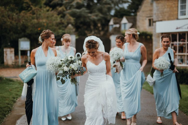 Bridesmaids In Baby Blue Multiway Dresses // Glastonbury Themed Table Plan For Wedding At Stone Barn Cotwolds With Groom In Cad & The Dandy Images Meghan Lorna