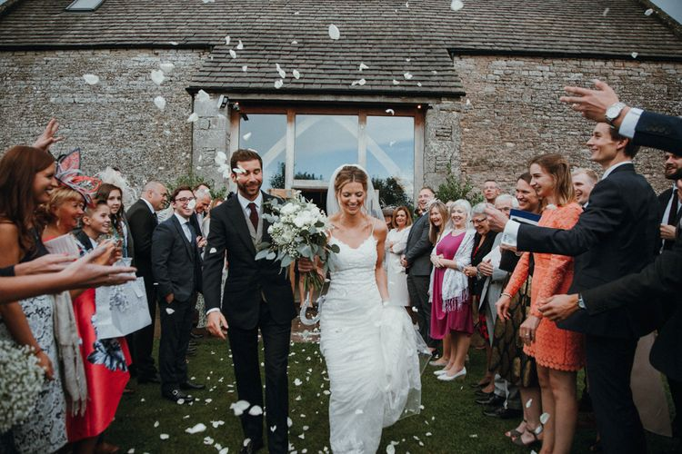 Confetti Shot // Glastonbury Themed Table Plan For Wedding At Stone Barn Cotwolds With Groom In Cad & The Dandy Images Meghan Lorna