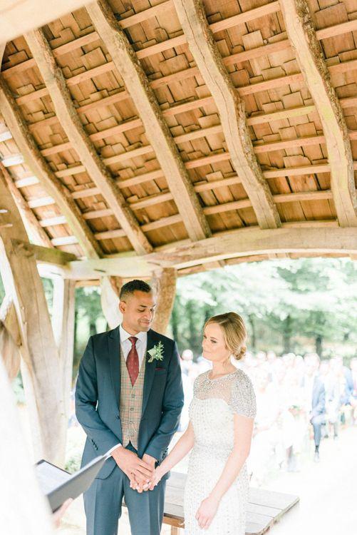 Wedding Ceremony with Bride in Beaded Wedding Dress and Groom in Dark Suit & Check Waistcoat