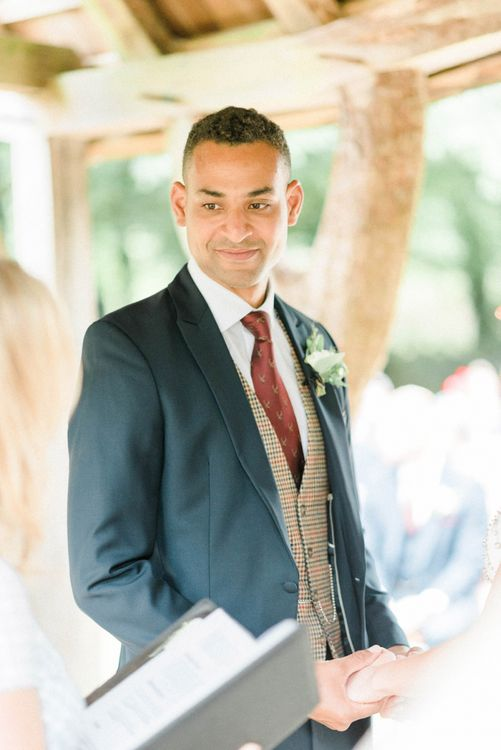 Groom at the Altar in Dark Suit, Brown Check Waistcoat and Burgundy Tie