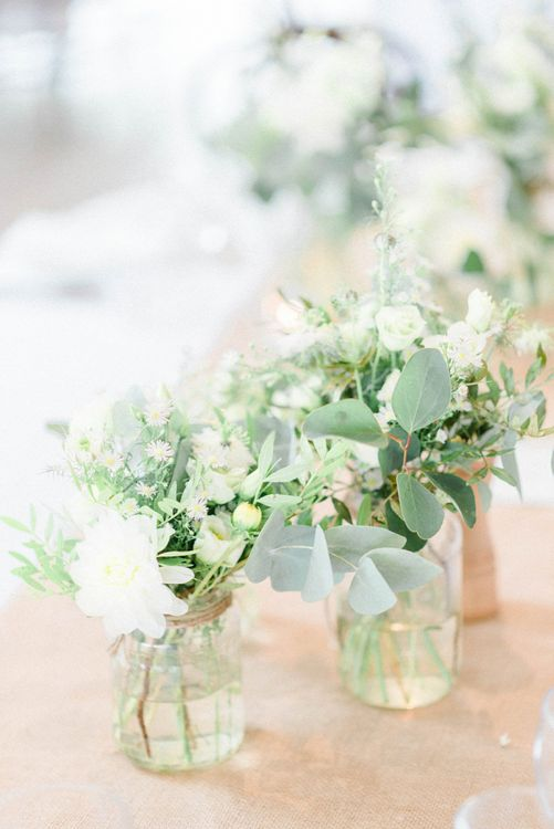 White and Green Wedding Flowers in Bottles