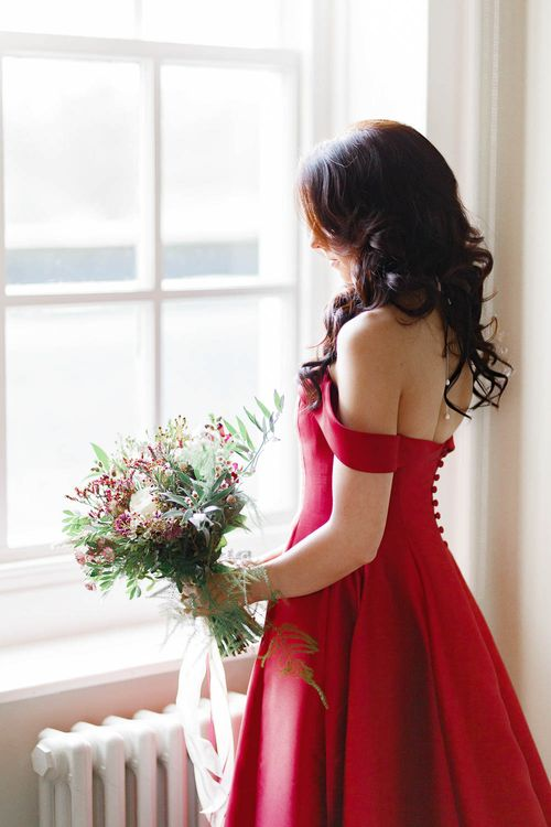 Bride in Bespoke Red Dress from Agape Bridal Boutique   Red New Years Eve Winter Wedding at Iscoyd Park, Shropshire   White Stag Wedding Photography   Lovetwofilm