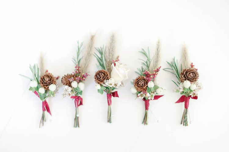 Winter Buttonholes   Red New Years Eve Winter Wedding at Iscoyd Park, Shropshire   White Stag Wedding Photography   Lovetwofilm