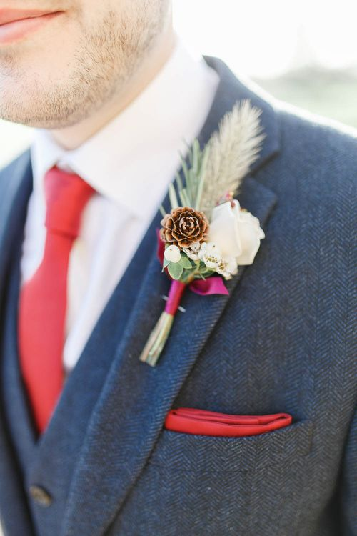 Winter Buttonhole   Red New Years Eve Winter Wedding at Iscoyd Park, Shropshire   White Stag Wedding Photography   Lovetwofilm