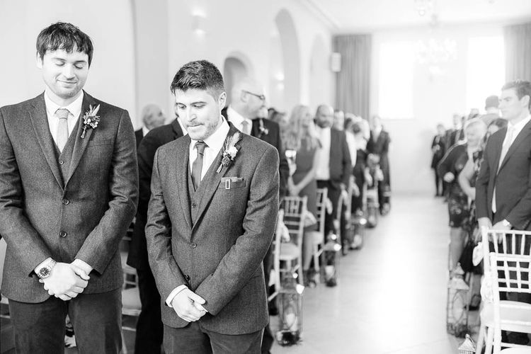 Groom at the Aisle in Slater Suit   Red New Years Eve Winter Wedding at Iscoyd Park, Shropshire   White Stag Wedding Photography   Lovetwofilm