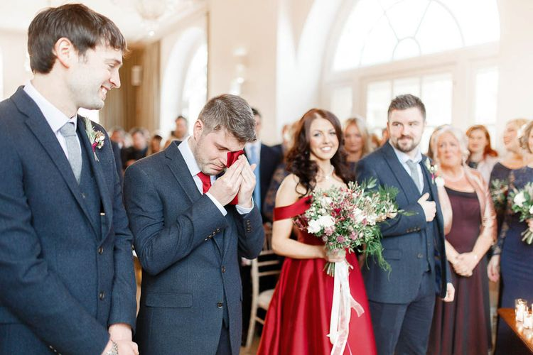 Wedding Ceremony   Bride in Bespoke Red Gown from agape Bridal Boutique   Groom in Slaters Suit   Red New Years Eve Winter Wedding at Iscoyd Park, Shropshire   White Stag Wedding Photography   Lovetwofilm