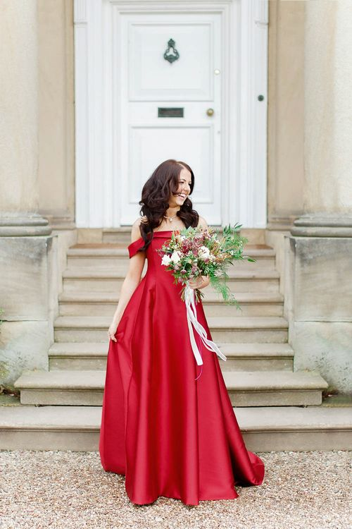 Bride in Bespoke Red Gown from agape Bridal Boutique   Red New Years Eve Winter Wedding at Iscoyd Park, Shropshire   White Stag Wedding Photography   Lovetwofilm