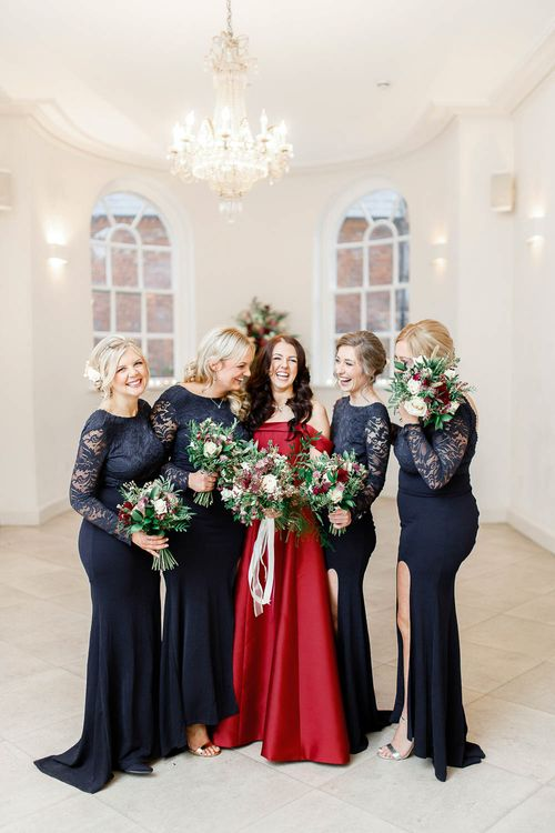 Bridal Party   Bridesmaids in Lace Navy Dresses   Bride in Bespoke Red Gown from agape Bridal Boutique   Red New Years Eve Winter Wedding at Iscoyd Park, Shropshire   White Stag Wedding Photography   Lovetwofilm