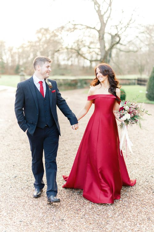Bride in Bespoke Red Gown from agape Bridal Boutique   Groom in Slaters Suit   Red New Years Eve Winter Wedding at Iscoyd Park, Shropshire   White Stag Wedding Photography   Lovetwofilm
