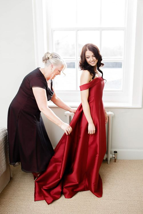 Wedding Morning Bridal Preparations   Bride in Bespoke Red Dress from Agape Bridal Boutique   Red New Years Eve Winter Wedding at Iscoyd Park, Shropshire   White Stag Wedding Photography   Lovetwofilm
