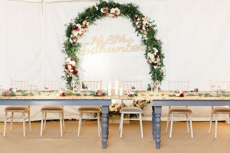 Floral Hoop Top Table Wedding Decor   Wedding Reception Decor   Red New Years Eve Winter Wedding at Iscoyd Park, Shropshire   White Stag Wedding Photography   Lovetwofilm