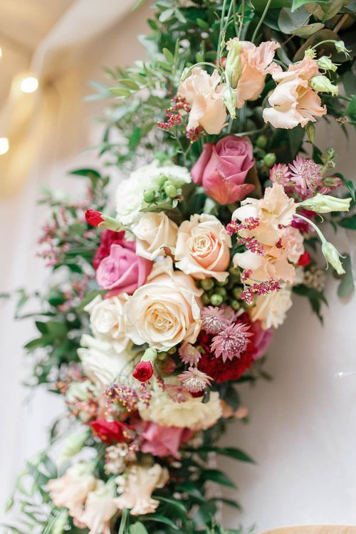 Red & Pink Wedding Flowers   Floral Hoop   Wedding Reception Decor   Red New Years Eve Winter Wedding at Iscoyd Park, Shropshire   White Stag Wedding Photography   Lovetwofilm