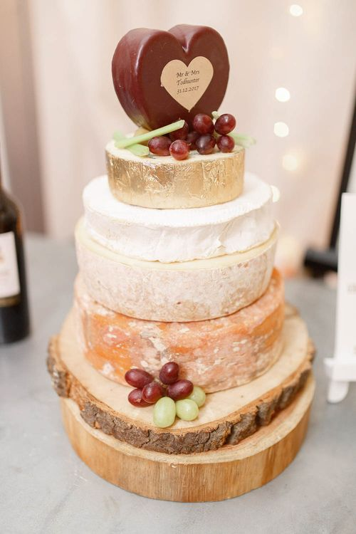 Cheese Tower Wedding Cake   Red New Years Eve Winter Wedding at Iscoyd Park, Shropshire   White Stag Wedding Photography   Lovetwofilm