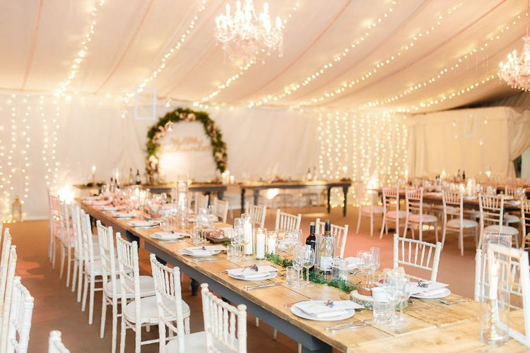 Wedding Reception Decor   Floral Hoop   Fairy Lights   Red New Years Eve Winter Wedding at Iscoyd Park, Shropshire   White Stag Wedding Photography   Lovetwofilm