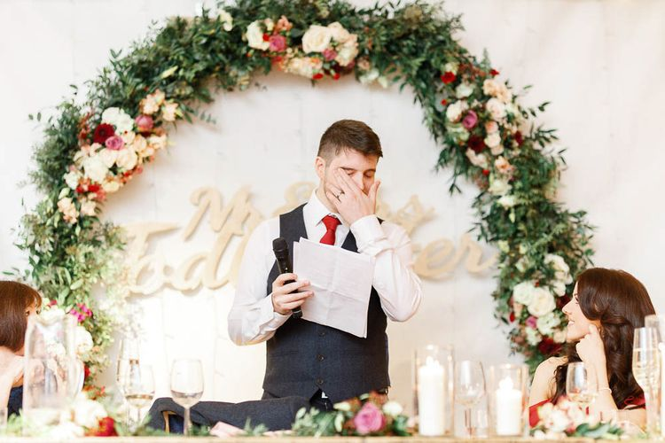 Wedding Reception Speeches   Floral Hoop   Top Table Decor   Groom in Slaters Suit   Red New Years Eve Winter Wedding at Iscoyd Park, Shropshire   White Stag Wedding Photography   Lovetwofilm