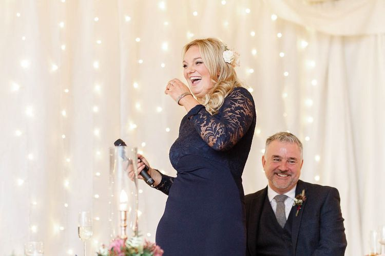 Wedding Reception Speeches   Bridesmaid in Navy Dress   Red New Years Eve Winter Wedding at Iscoyd Park, Shropshire   White Stag Wedding Photography   Lovetwofilm