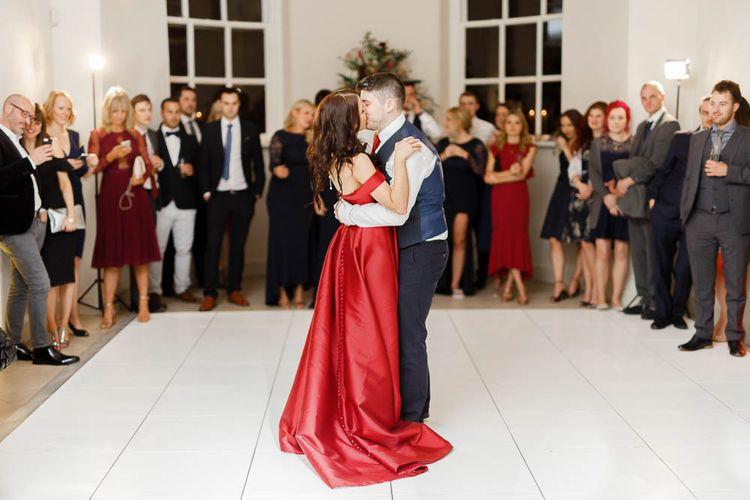 First Dance   Bride in Bespoke Red Gown from agape Bridal Boutique   Groom in Slaters Suit   Red New Years Eve Winter Wedding at Iscoyd Park, Shropshire   White Stag Wedding Photography   Lovetwofilm