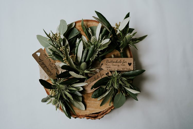 Foliage buttonholes for groomsmen