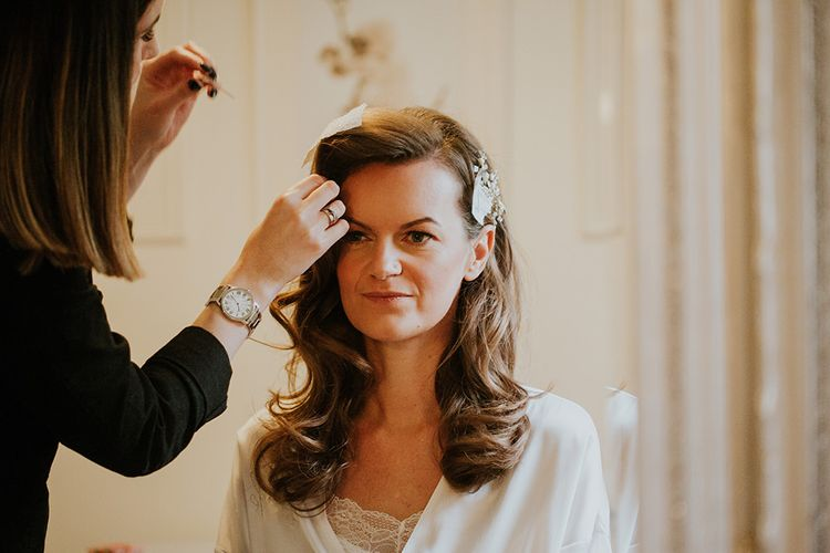 Bride has her hair styled