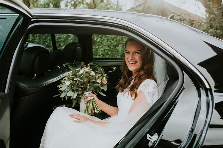 Bride arrives at wedding in car