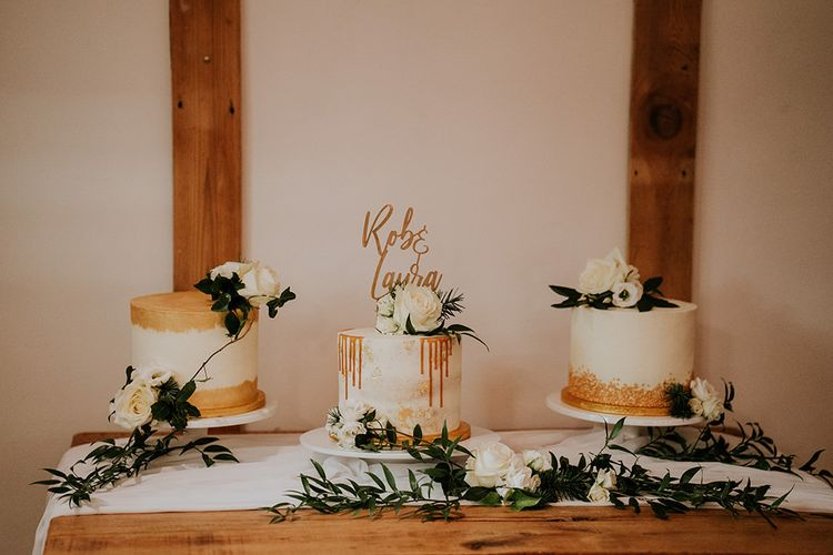 Separate wedding cakes with gold detail