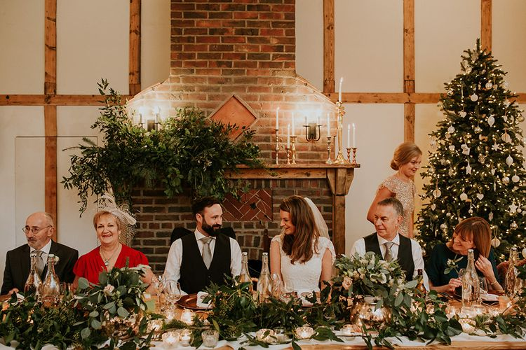 Top table wedding decor with Christmas tree for winter wedding