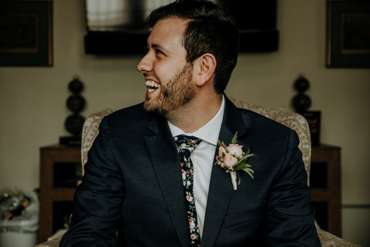 Groom in Navy Suit and Floral Tie | Pink Buttonhole | Rifle Paper Co. Trainers for Informal Wedding in Fort Worth, Texas | Paul & Nanda Photography