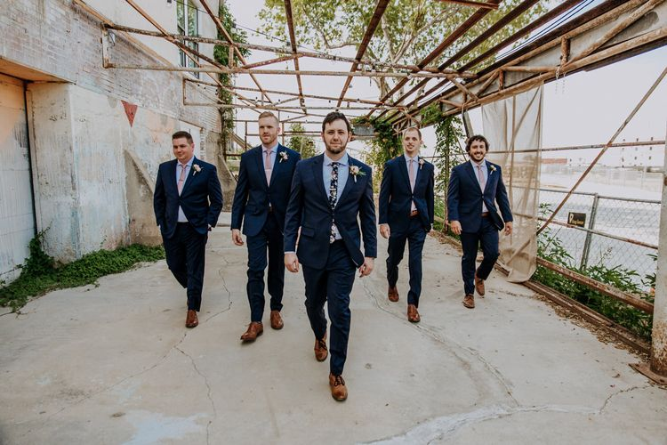 Groom in Navy Suit and Floral Tie | Groomsmen in Navy Suits and Silk Blush Ties | Pink Buttonholes | Rifle Paper Co. Trainers for Informal Wedding in Fort Worth, Texas | Paul & Nanda Photography