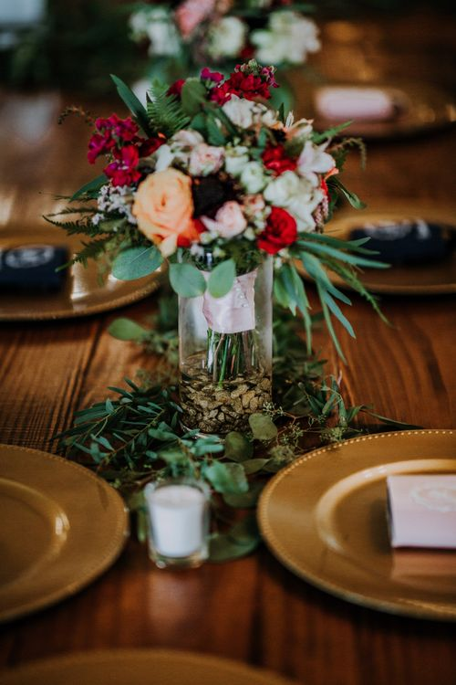 Wedding Reception Décor | Pinwheel Table Configuration | Gold Charger Plates | Eucalyptus Garland | Colourful Bouquet of Pink, Orange and Red Flowers with Ferns, Eucalyptus and Greenery | Tea Lights | Rifle Paper Co. Trainers for Informal Wedding in Fort Worth, Texas | Paul & Nanda Photography