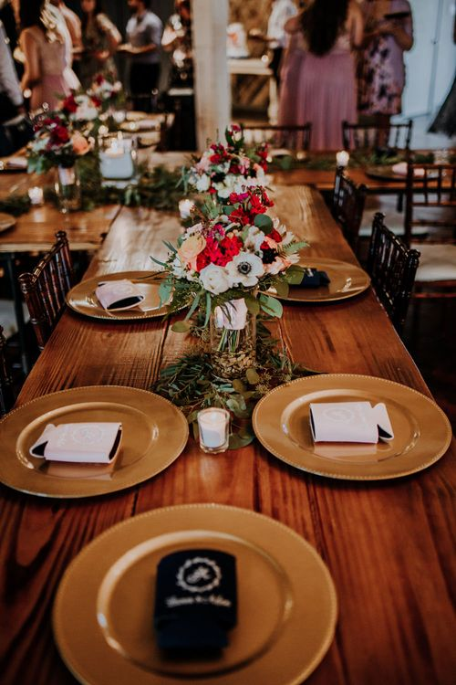Wedding Reception Décor | Pinwheel Table Configuration | Gold Charger Plates | Eucalyptus Garlands | Koozie Wedding Favours | Colourful Bouquet of Pink, Orange and White Flowers with Ferns, Eucalyptus and Greenery | Candles | Rifle Paper Co. Trainers for Informal Wedding in Fort Worth, Texas | Paul & Nanda Photography