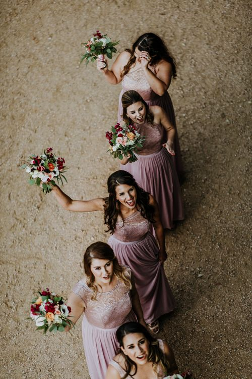 Bridesmaids in Pink Dresses with Lace Bodice | Colourful Bouquets of Pink, Orange and White Flowers with Ferns, Eucalyptus and Greenery | Rifle Paper Co. Trainers for Informal Wedding in Fort Worth, Texas | Paul & Nanda Photography