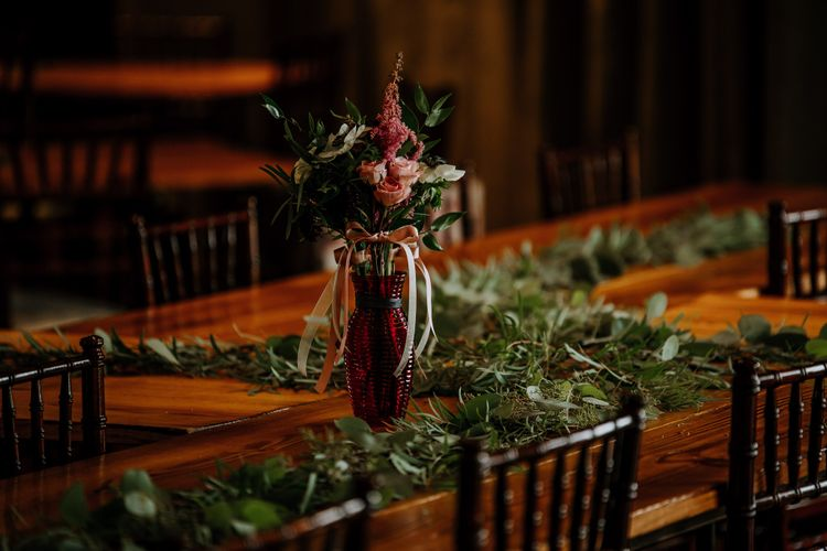 Wedding Reception Décor | Pinwheel Table Configuration | Eucalyptus Garland | Pink Flowers and Foliage in Red Vase | Rifle Paper Co. Trainers for Informal Wedding in Fort Worth, Texas | Paul & Nanda Photography