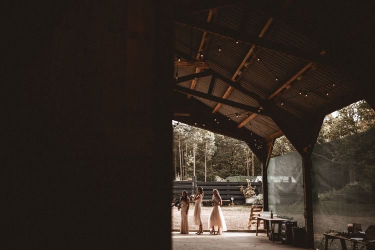 Bridesmaids In Pale Pink Coast Dresses // Rustic Wedding With Outdoor Ceremony At Captains Woods Barn With Bride In Coco And Kate Images From Benjamin Wheeler Jay Films