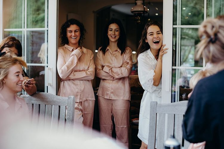 Bridal party preparations for pub wedding with layered wedding dress