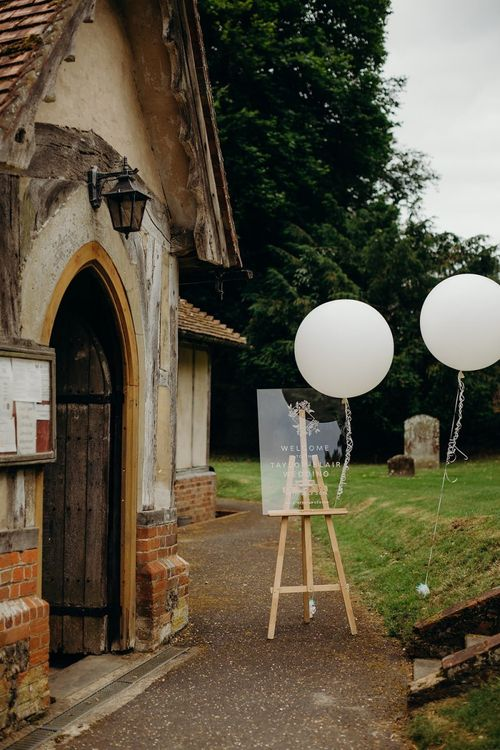 Acrylic wedding sign with balloons at church ceremony
