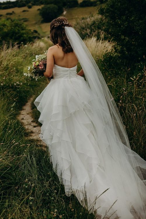 Strapless layered wedding dress with long veil